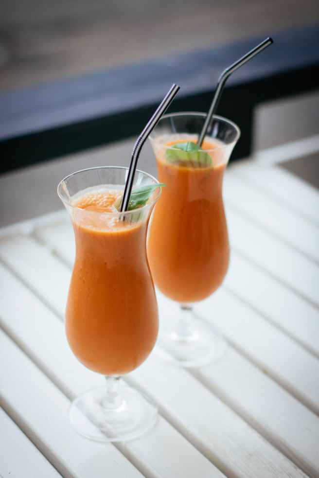 selective focus photography of two orange drinks