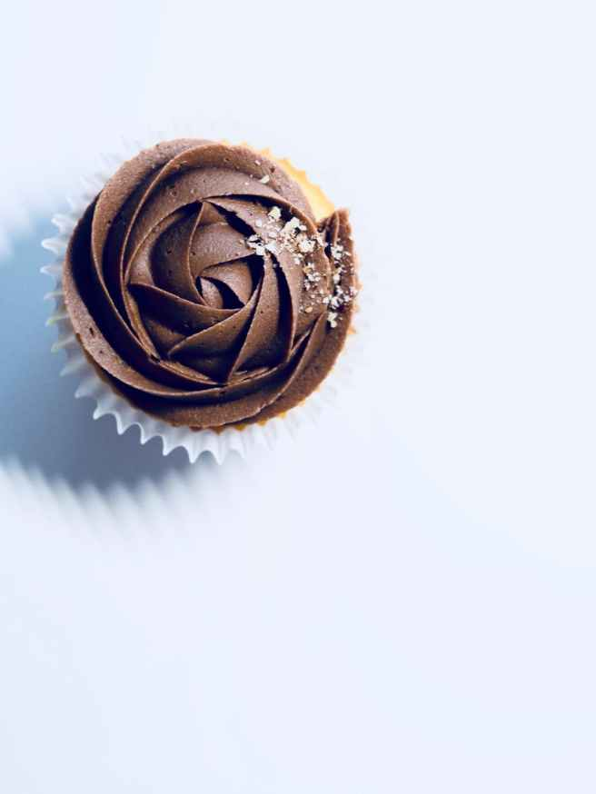 chocolate cupcake on white surface