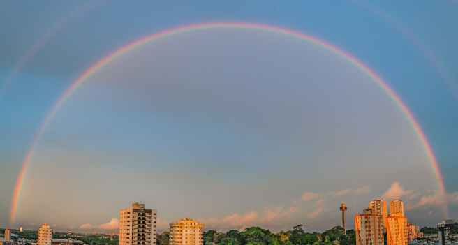 rainbow over high rise buildings