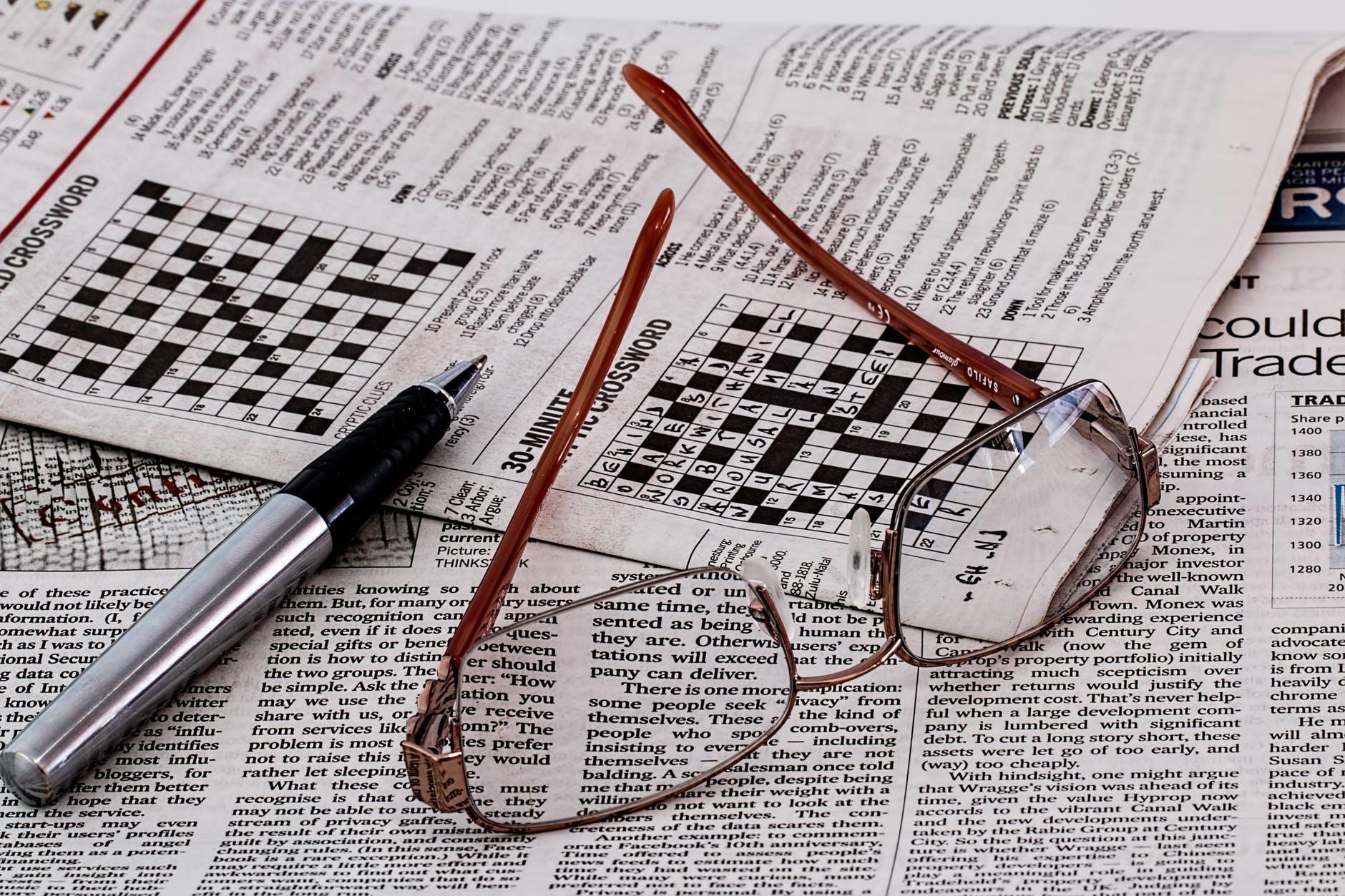 frame less eyeglasses on newspaper