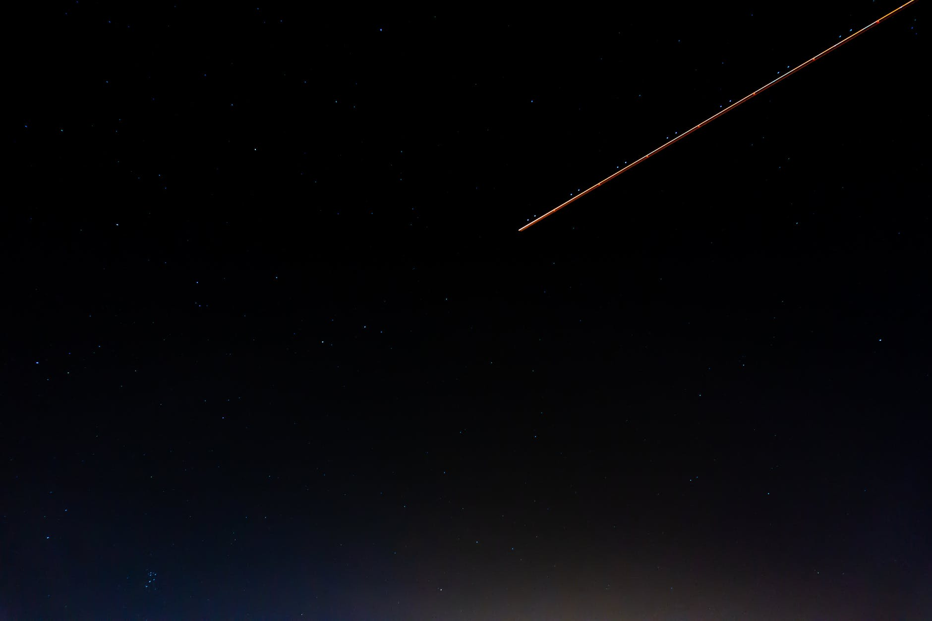 photo of shooting star during night time