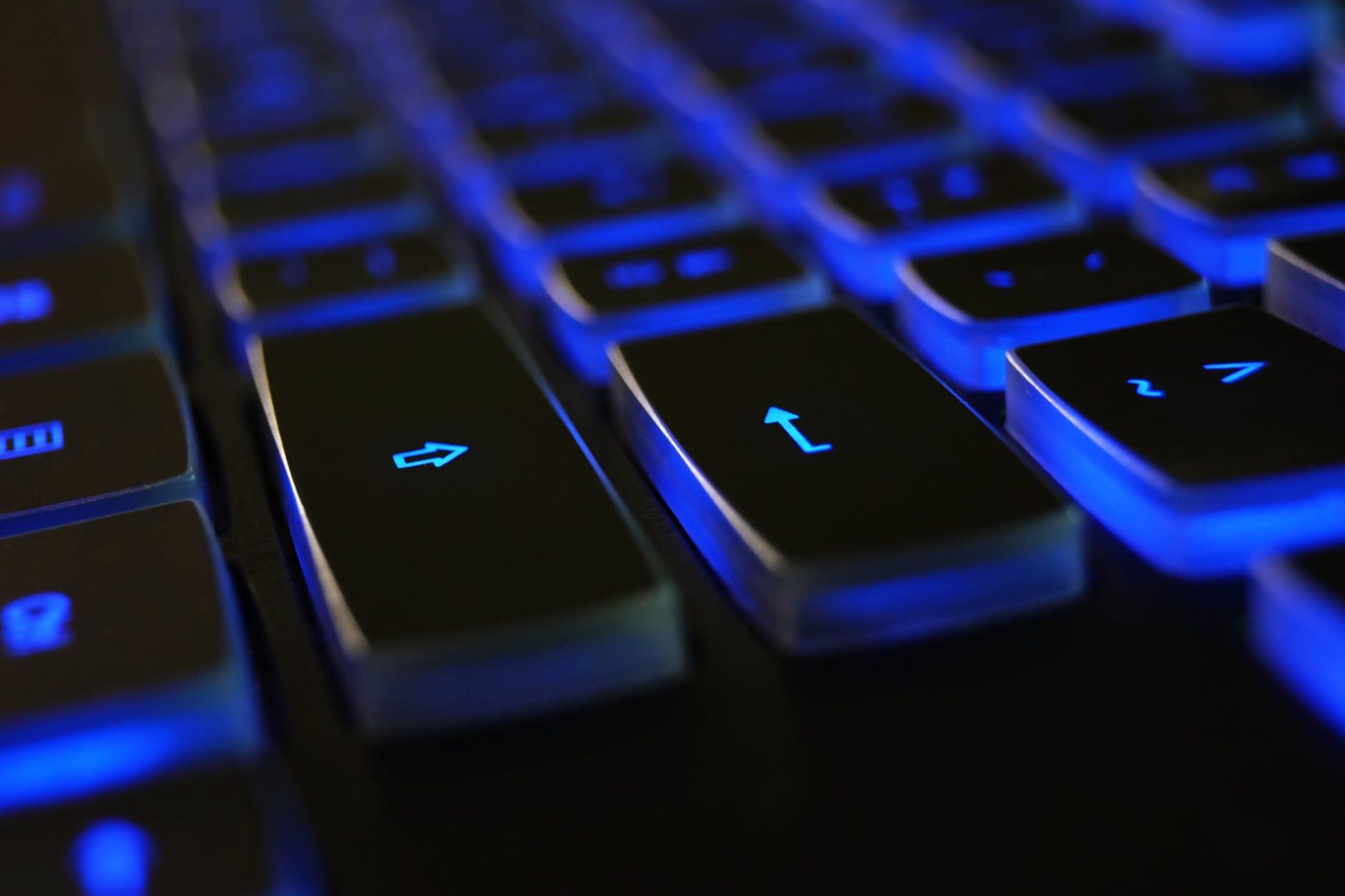 closeup photo of black and blue keyboard
